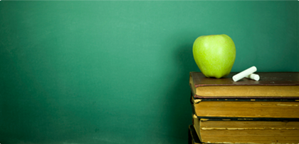 Photo of books and an apple