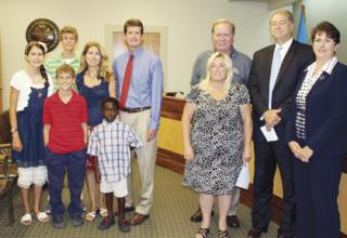 Photo of new aldermen and families